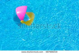 swimming pool beach ball background. Summer Holiday Background, Inflatable Beach Ball Floating On Refreshing  Blue Swimming Pool Water. Background M
