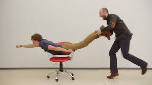Fun office chairs Ladies Office Office Chair Race Slow Motion Young Guys Have Fun In The Office During Break Games Of Businessmen From Large Offices Men Celebrate Successful Deal The Hathor Legacy Video Stock Tema Office Chair Race Slow Motion 100 Royalty