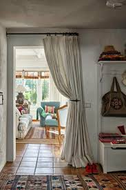 curtains as elegant room divider for small home design. tricks> color  blends into the wall, hang the curtains high to make room seem