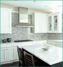 white kitchen cabinets with grey backsplash glass tile backsplash white cabinets