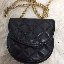 67% off Handbags - Mini leather quilted gold chain purse from Omp ... & Bags - Mini leather quilted gold chain purse Adamdwight.com