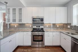 image of white kitchen cabinets with granite countertops
