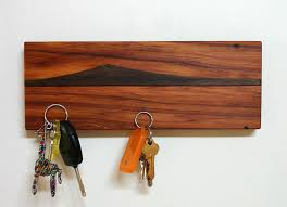 Add a small piece of artwork to your wall with this magnetic wooden key  holder featuring an island view from New Zealand.