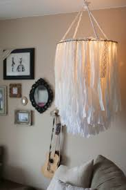 enjoy a warm glow with this luxe light fitting made from fabric strips and lacy ss