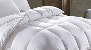 a fluffed up and soft down comforter