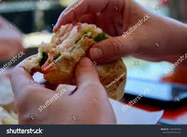 Hands Eating Lobster Roll Eating Lunch ...
