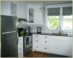 white kitchen cabinets with glass tile backsplash delightful pictures of kitchen decoration