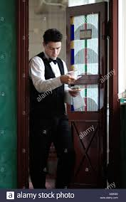 Restaurant Kitchen Door Waiter Carrying Desserts Coming Through The Kitchen Door Of A Busy