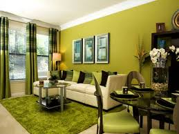 Living Room. green wall theme and green fabric curtains also green cushions  on white fabric
