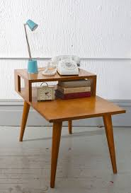 mid century modern russel wright side table with retro aqua lamp and white rotary phone