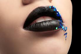 black lipstick with blue sequins