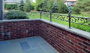 this ornate wrought iron vine design lends itself to a very nice brick wall topper while adding to the safety and security of the landing
