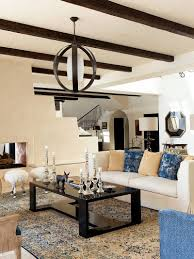 mediterranean living room with a curated hint of black design brion jeannette architecture