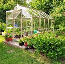 backyard garden. A Greenhouse Is Great Tool In Vegetable Garden If You Have The Room For Backyard