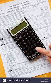 Calculator Calculating Income Taxes On Tax Form Expenses