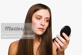 Woman Looking at Compact Mirror Stock Photo Masterfile Rights