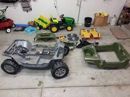 hello from wisconsin modifiedpowerwheels com in the background you can see a peg perego ground force that is currently my son s age 4 and the jeep hurricane is going to be a b day gift for my