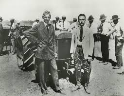 henry ford and his wife and son. henry ford and edsel with fordson tractor 1921 his wife son