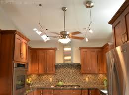 ceiling fan light location and aim in air conditioned kitchen