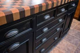 black wood countertops black kitchen island with checkerboard butcher block dark stained wood countertops white cabinets