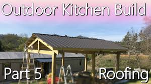 this post completes the major construction of the outdoor kitchen woo hoo in this post i go through the installation of our metal roofing