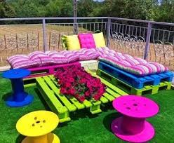 bright colored furniture. i like this but would do it in white or coral instead of the bright colors outdoor furniture using pallets home yard decorate patio diy deck ideas colored r