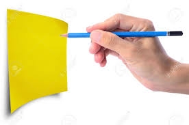 man s hand holding pencil writing on blank yellow paper note  man s hand holding pencil writing on blank yellow paper note you can write your own