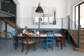 dining chairs in living room. example of a large eclectic gray floor kitchen/dining room combo design in london with dining chairs living