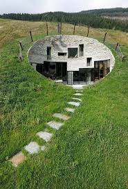 house plans built into a hill