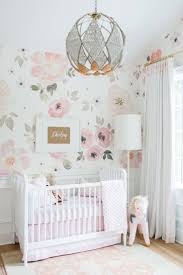 Monika Hibbs' nursery is a perfect, girly space... from the wallpaper,  light fixture, and drapery. Monika designed the drapery with double  grosgrain ribbon ...