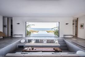 this house has a sunken living room that allows for uninterrupted ocean views