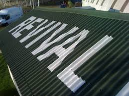 hand painted lettering onto corrogated roof osborne signs