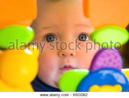Gifts For 6 Month Old Boy Baby Girl Toddler With Blue Eyes Looking Through Plastic Toys Stock Photo Christmas Boyfriend