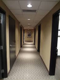 office hallway. Hallway Of Medical Office With Carpet, Custom Stained Oak Doors And Recessed Can Lighting