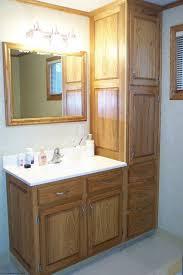 modern bathroom linen cabinets. Small Bathroom Decoration Using Solid Light Oak Wood Vanity Linen Cabinets Including Three Modern