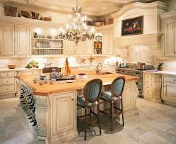 beautiful vintage kitchen design with square kitchen island table equipped by sink and furnished also wine cellar storage over elegant crystal chandelier