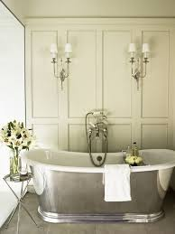 french inspired lighting. this french style bath decor features a gorgeous freestanding oval cast iron bathtub candide collection inspired lighting b