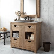 made from used wine staves this vanity features a mix of drawers and open shelves and