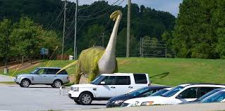 gwinnett missioners boot dinosaurs other sculptures from duluth ping center archive gwinnettdailypost