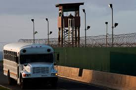 back to the future on detention and military commissions lawfare a u s navy bus passes camp delta a prison at guantanamo bay photo u s air force