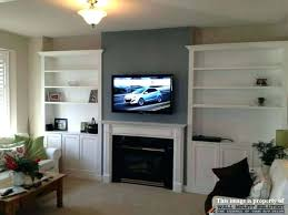 hanging tv above fireplace hanging above fireplace beautiful hide how to hang mount on brick without
