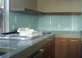 kitchen glass tile backsplash black wooden kitchen cabinet polished bright yellow wooden kitchen cainet flower patterned white window curtain polished white