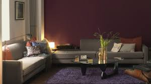 warm living room ideas: layer warm dark colours to create a cosy living room