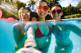 swimming pool with friends. Contemporary Swimming Joyful Friends Making Selfie In Swimming Pool Inside Swimming Pool With Friends D