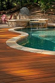 Wood deck adjoining an inground pool. Designed and built by Atlanta Decking.