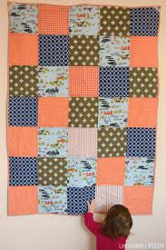 Orange and navy blue baby boy quilt - Lansdowne Life & Orange, navy, and olive patchwork baby quilt Adamdwight.com