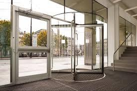 dorma all glass revolving door makes stunning entrance