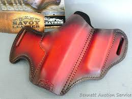 savoy leather pistol holster is 11 x 8 and was donated by savoy leather