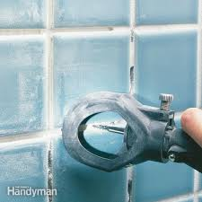Grouting wall tile White How To Regrout Bathroom Tile Fixing Bathroom Walls The Family Handyman How To Regrout Bathroom Tile Fixing Bathroom Walls The Family