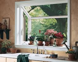 Grown herbs on back smaller bay window. Have a window that sticks out like  this